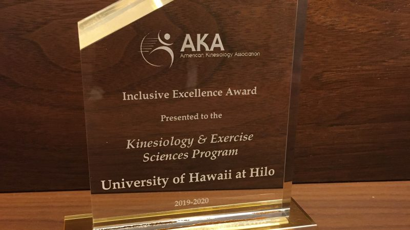Award with words: AKA American Kinisiology Association, Inclusive Excellence Award, Presented to the Kinisiology & Excercise Sciences Program University of Hawaii at Hilo 2019-2020.