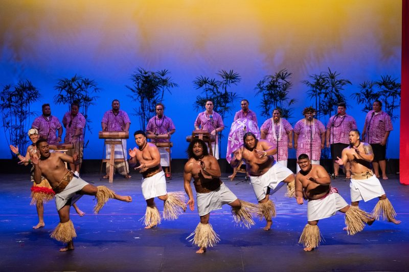 Group of male dancers in traditional Samoan attire.