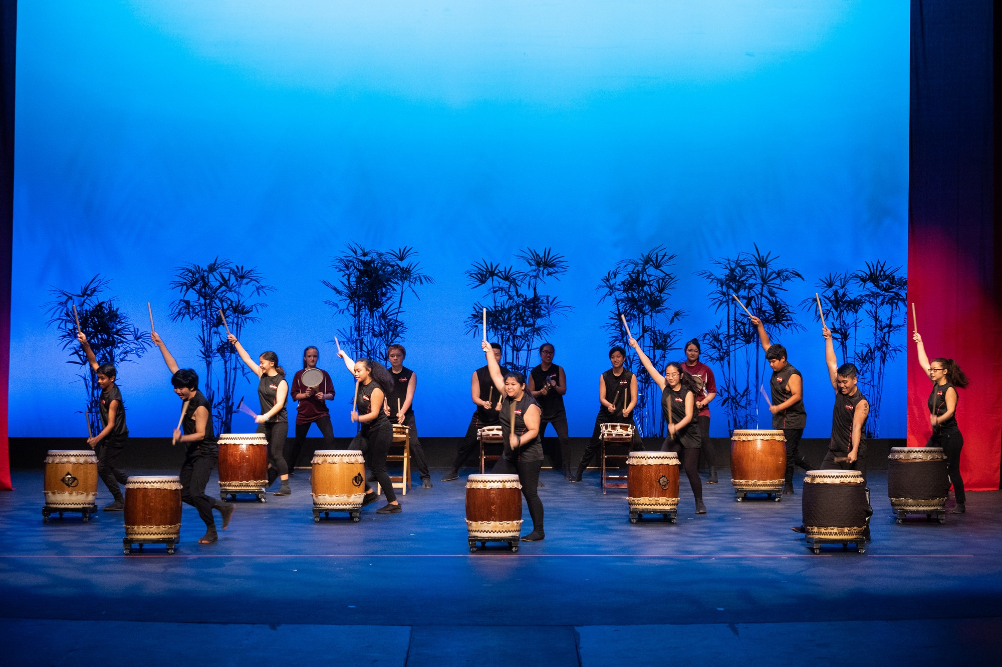 Group of Taiko drummers on stage.