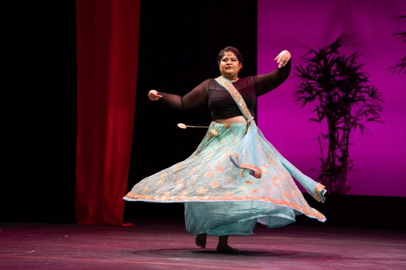Woman in full light blue skirt, swirling around.