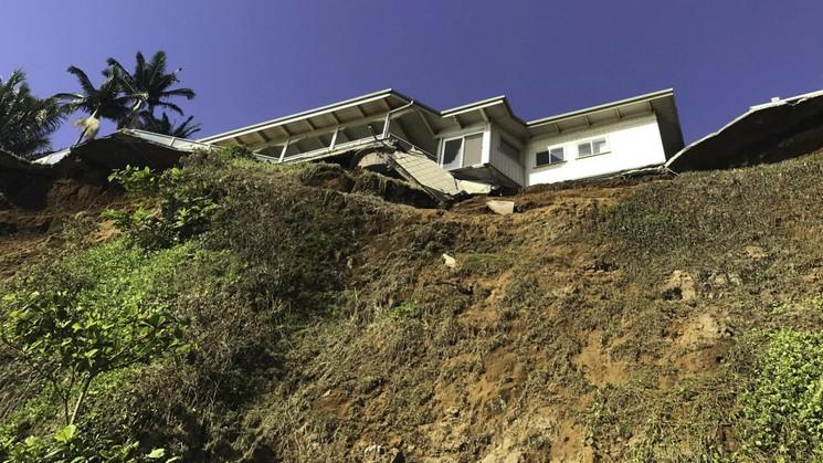 Landslide below house on cliff.