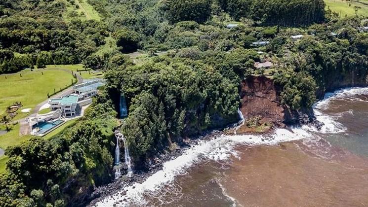 Landslide below community on cliff.