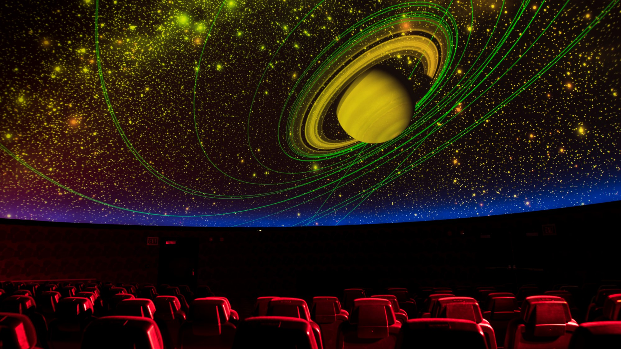 Theater seats with visual of solar system directly over head.