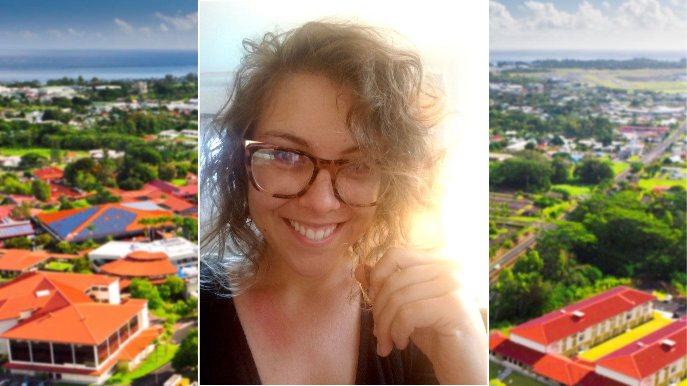 Emily Burkhart with aerial view of UH Hilo campus.
