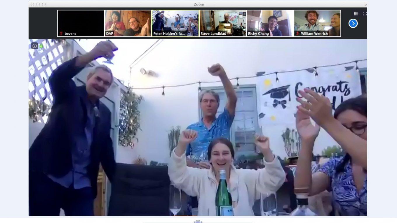 Family celebrating via Zoom