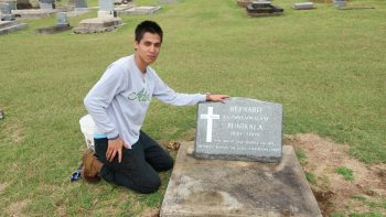 CJ Sweezey at grave marker.