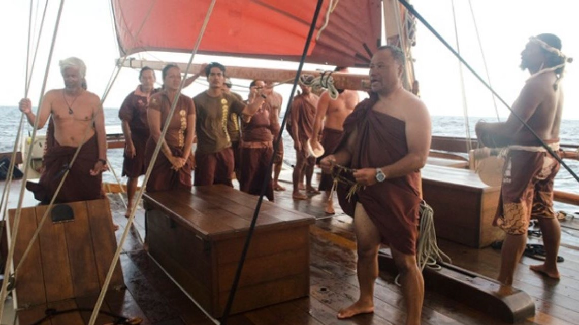 Voyagers on deck on voyaging canoe.