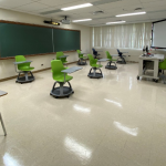 Classroom with desks spaced out six feet apart.