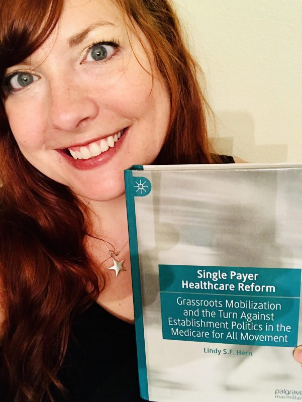 Lindy Hern holds her book entitled, Single Payer Healthcare Reform: Grassroots Mobilization and the Turn Against Establishment Politics in the Medicare for All Movement