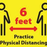 Sign: 6 feet, practice social distancing