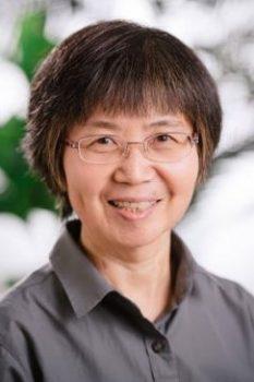 Leng Chee Chang smiling at camera.