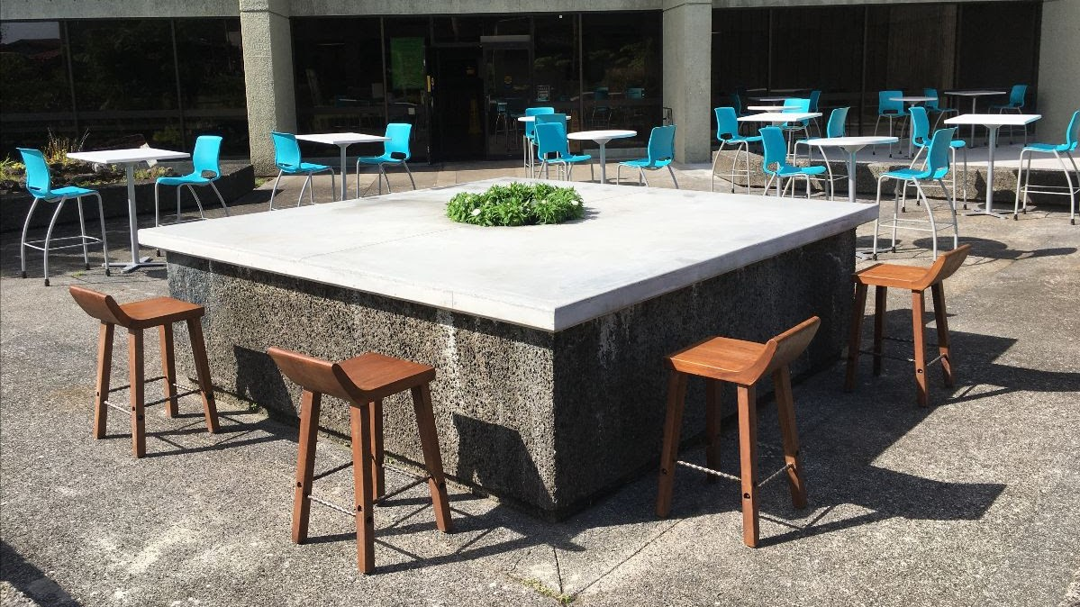 Large outdoor eating area with tables and chairs spaced out.