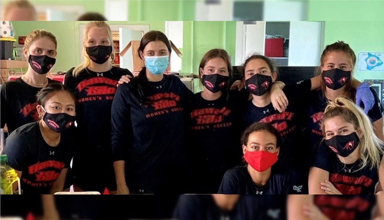 Vulcan soccer team, in masks, at recovery home.