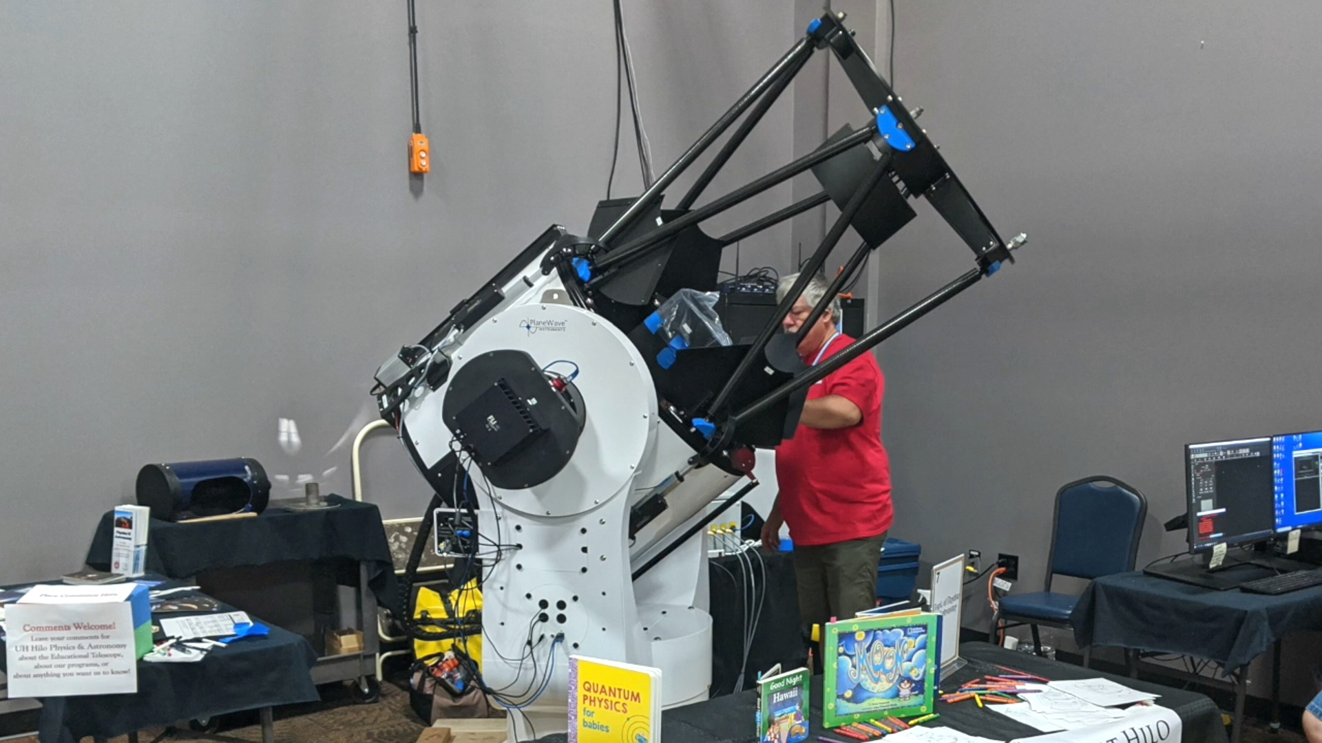 Man working on telescope in lab.
