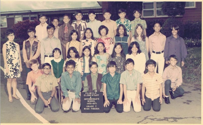 Class standing and kneeling for class photo.