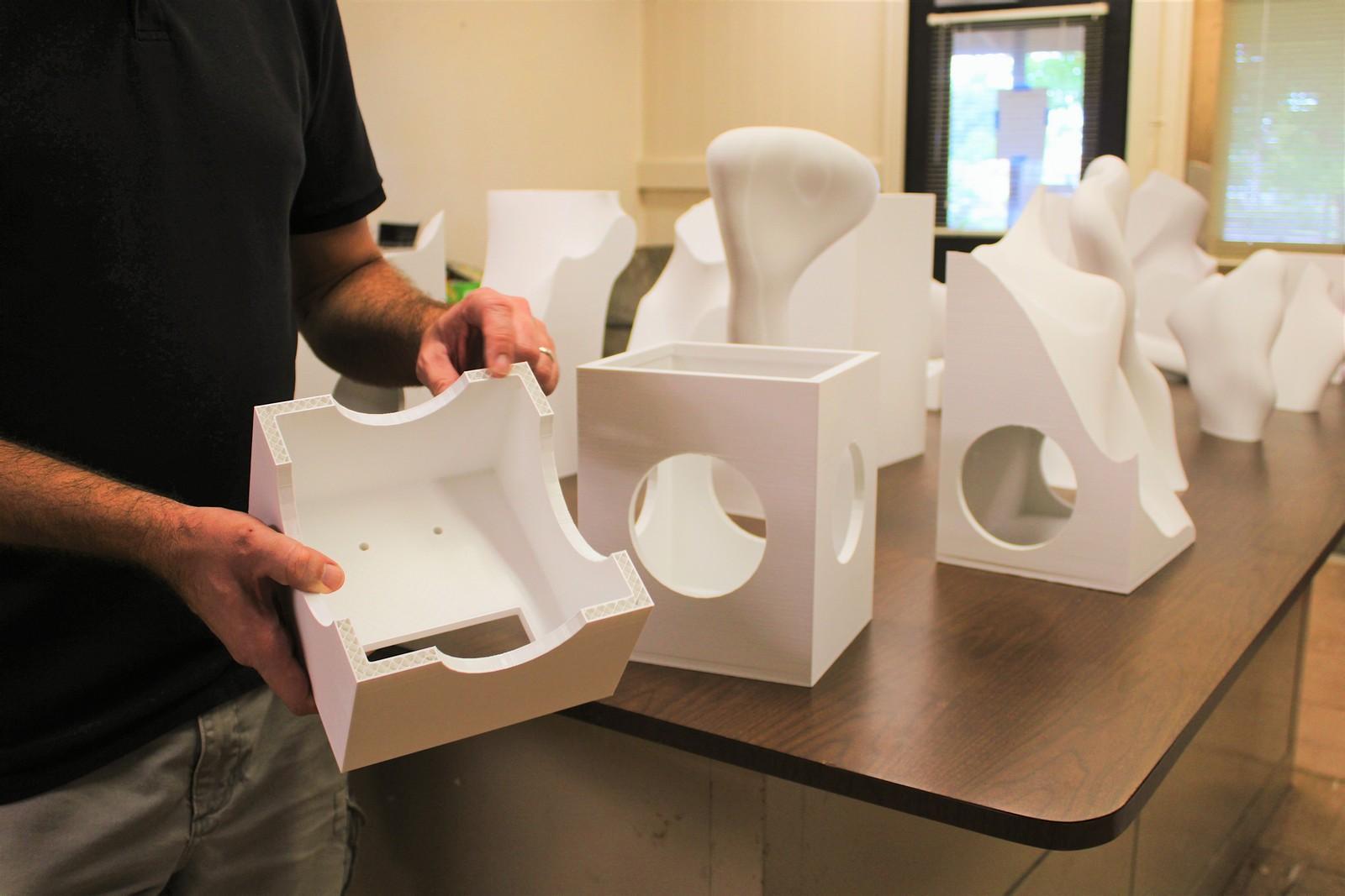 Jon Goebel holds a modular pieces of the sculpture.