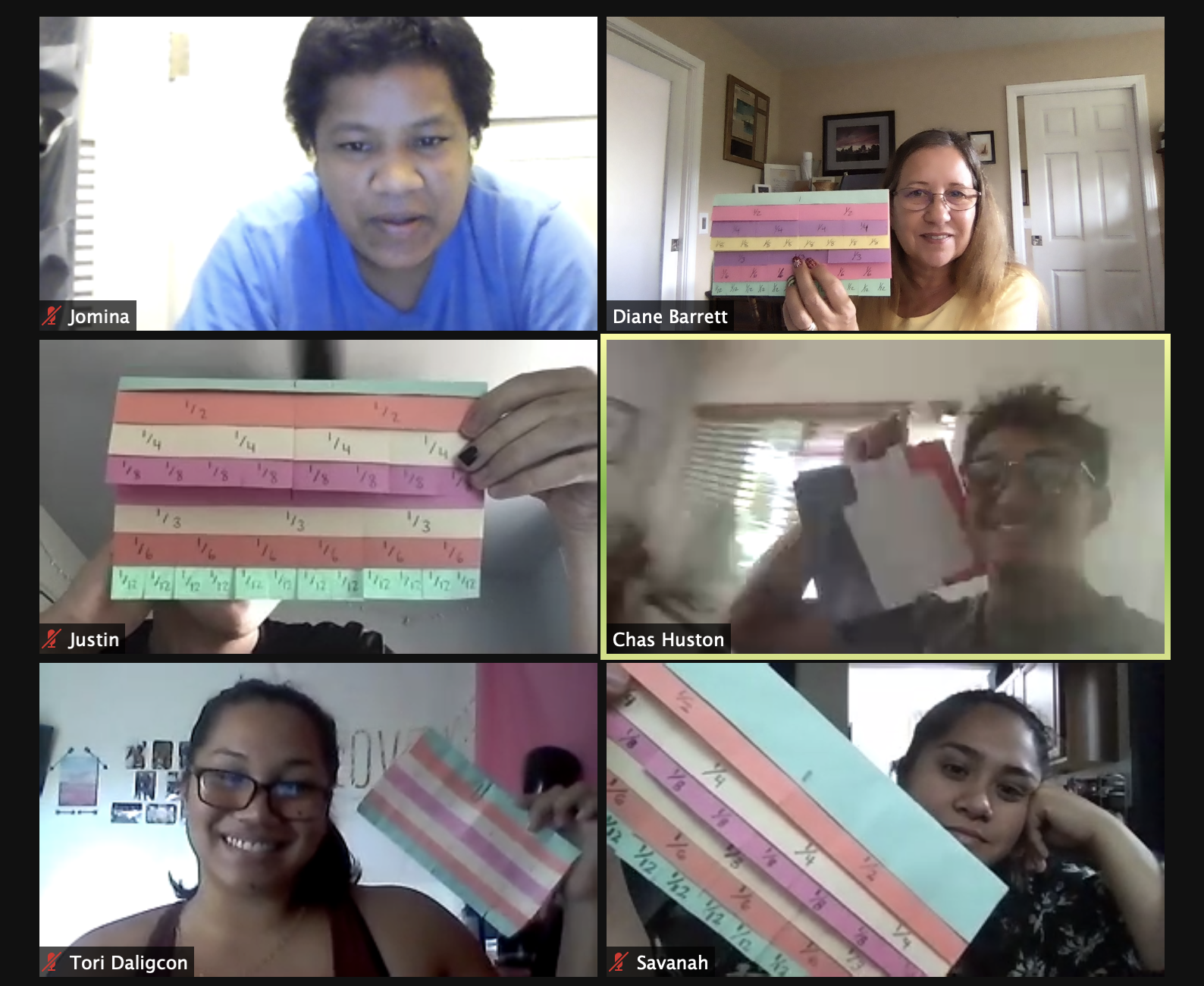 Screenshot of math class on Zoom with grid of student faces using manipulatives.