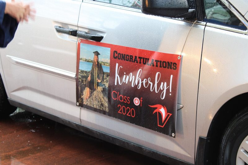 Sign on side of car: Congratulations Kimberly! Class 2020