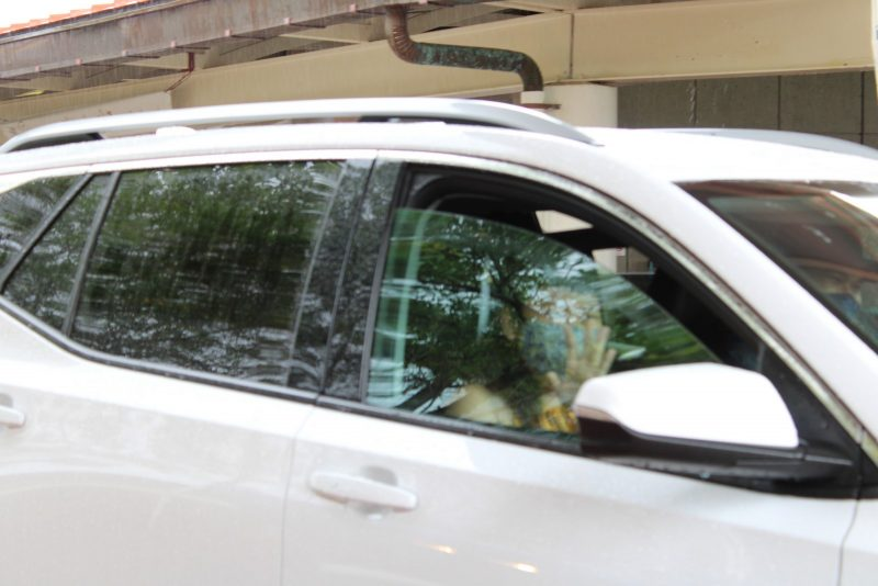 Graduate rolls up window as she passes by.