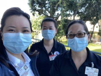 Three women wearing surgical masks.