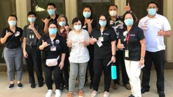 Group of pharmacy students and faculty, all wear masks