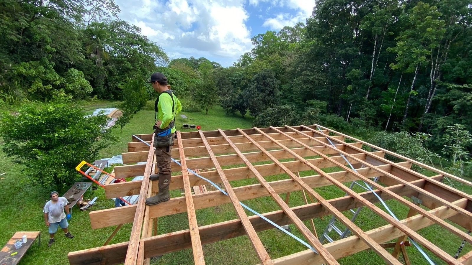 Jake stands on top of the framing of the new roof.
