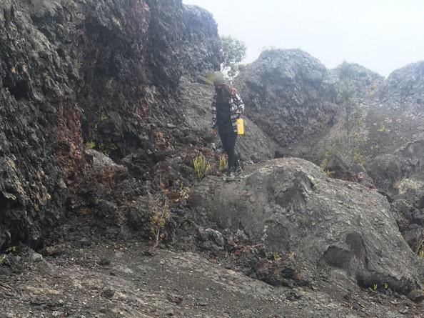 Student walk close to lava wall.