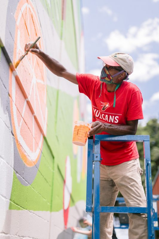 Michael Marshall paints mural.