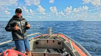 John Burns aboard small boat.