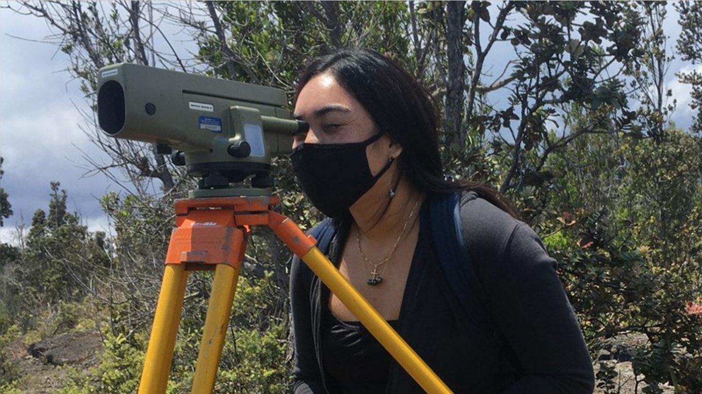 Female student using leveling gun.