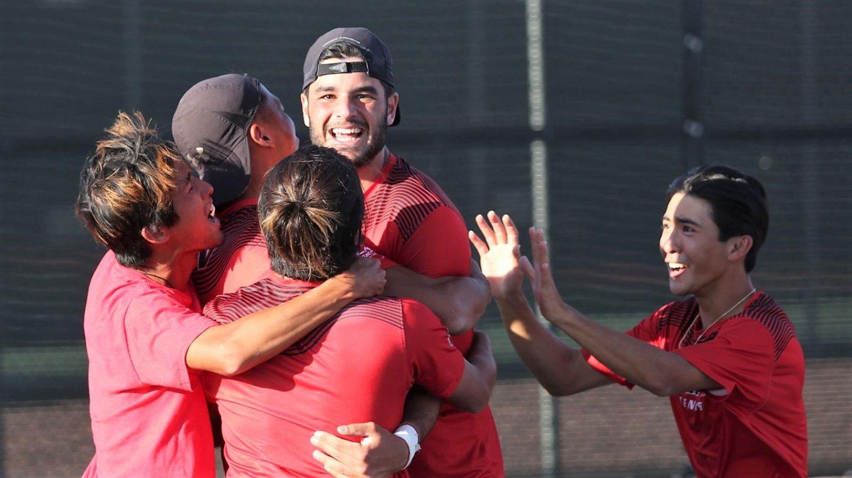 Tennis team celebrates.