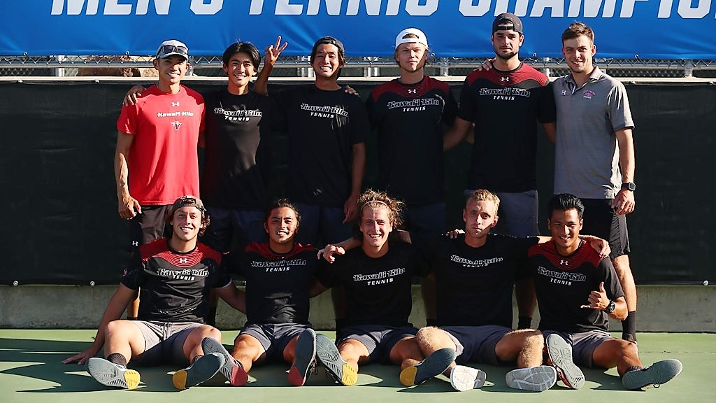 Tennis team poses for photo.