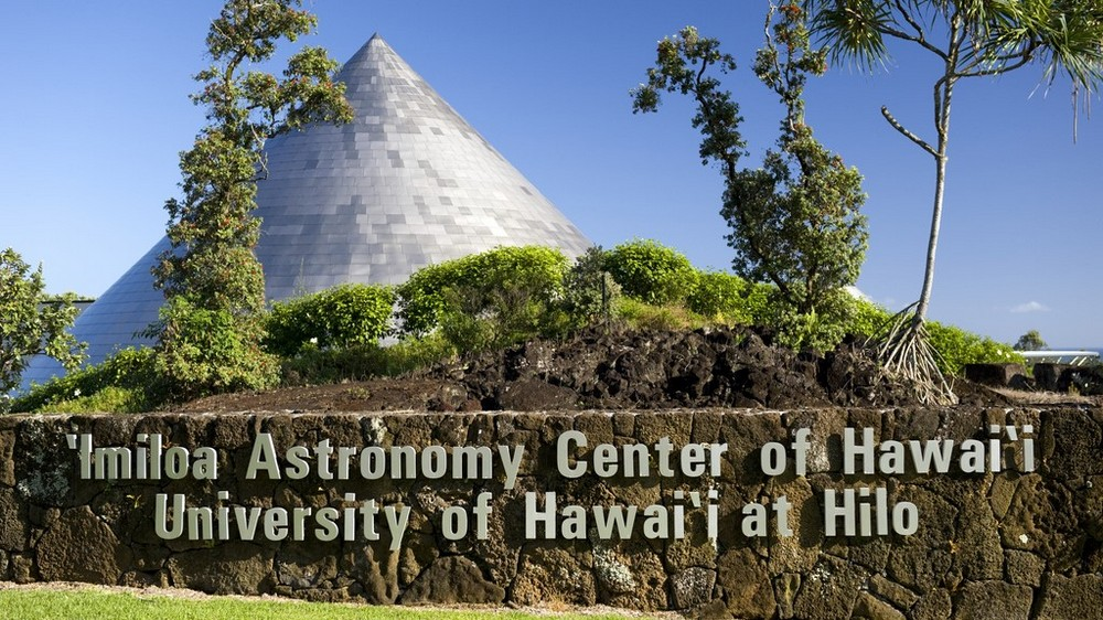Coned-shaped building at ʻImiloa Astronomy Center, with signage.