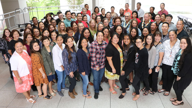 Student affairs staff stand for group photo.