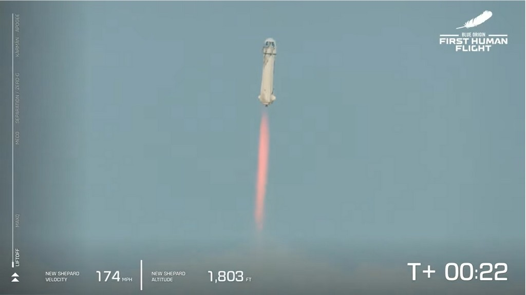 Rocket blasting off straight into the air with red glow of fuel trailing behind.