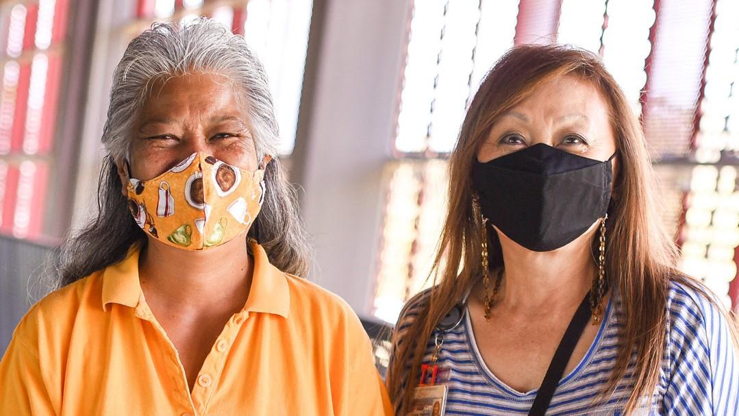 Lily Pua-Kaipo and Charlene Awa Cockett, wearing masks.
