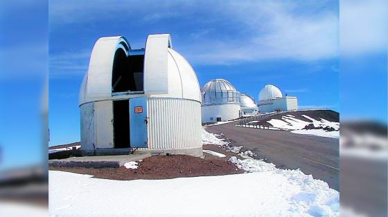 Small telescope atop Maunakea, in the snow.