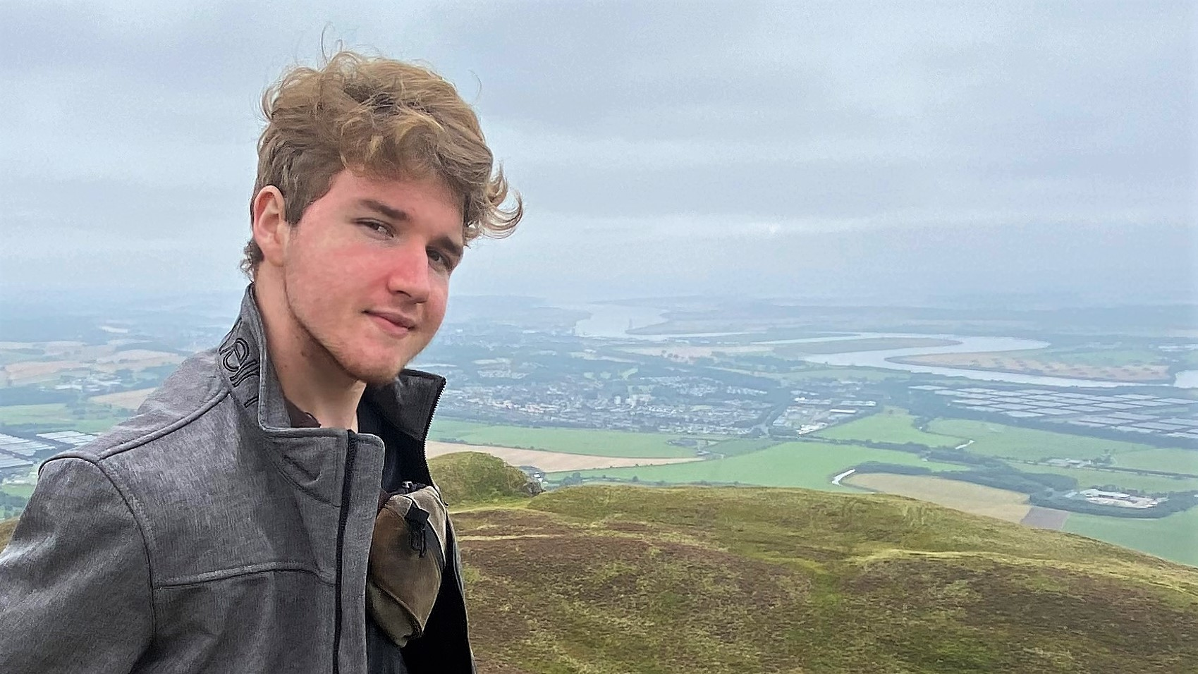 Kit Neikirk pictured with vast landscape in background.