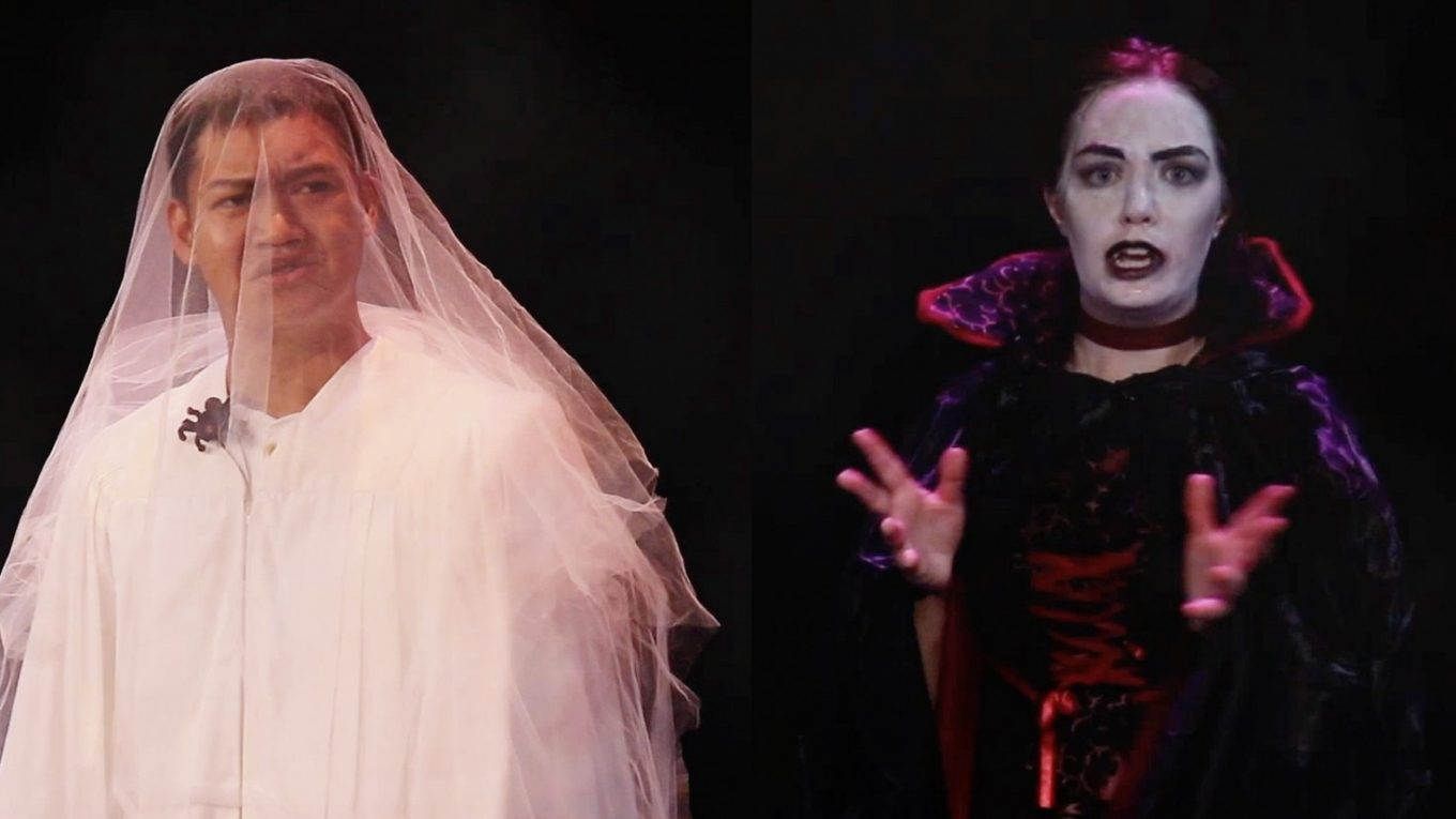 Man in bridal veil next to woman in horror costume.
