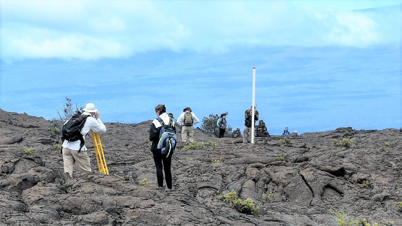 Pictured is a group of researchers out on the lava fields using measuring equipment.