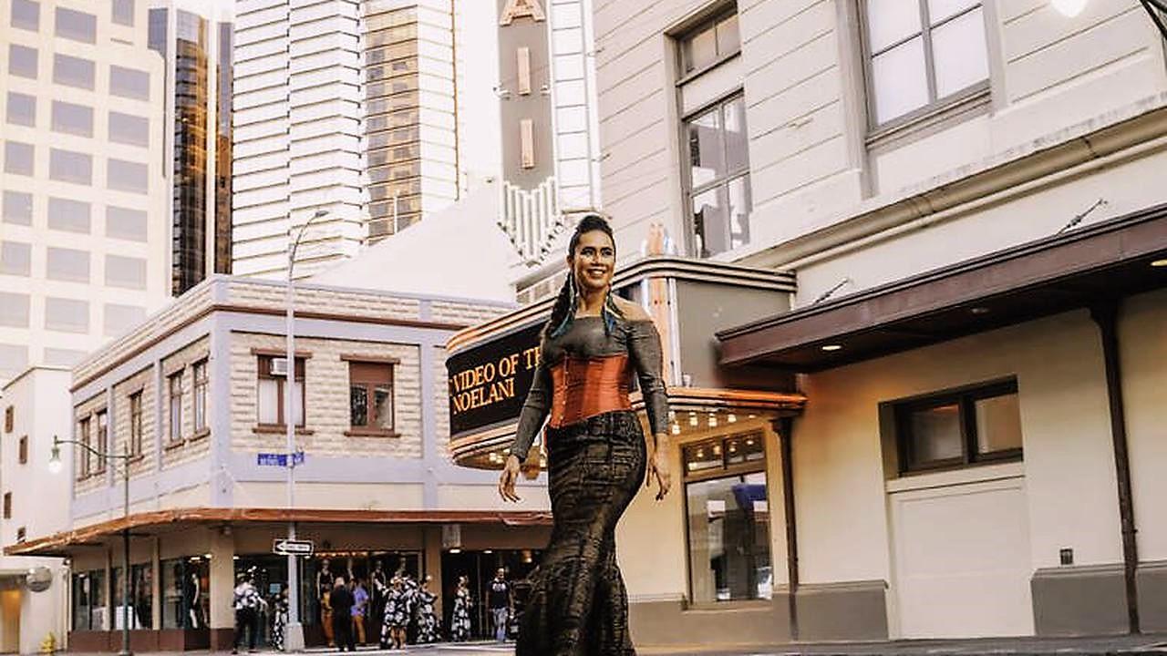 Kainani Kahaunaele walking in Honolulu.