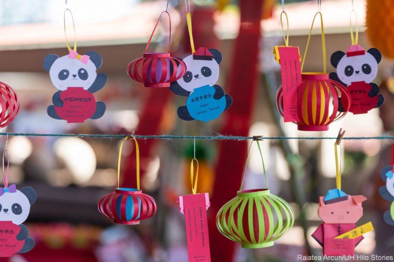 Paper art panda bears and lanterns.