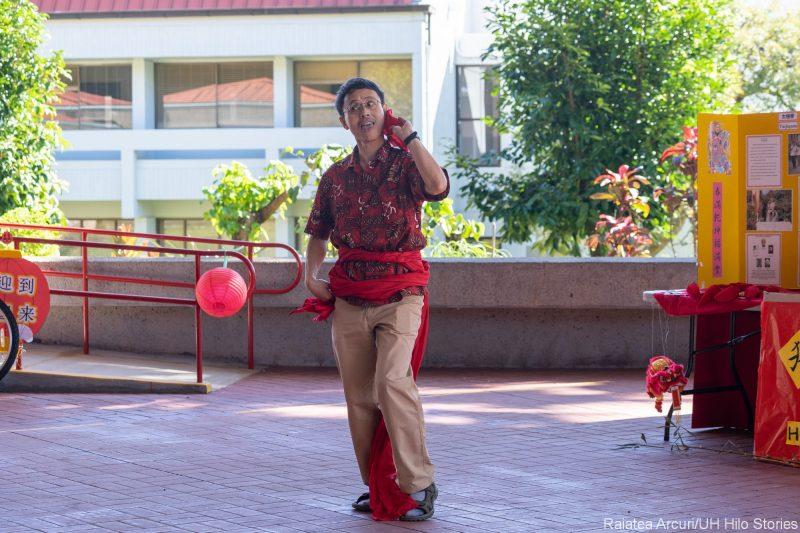 Jiren Feng dancing on Library Lanai.