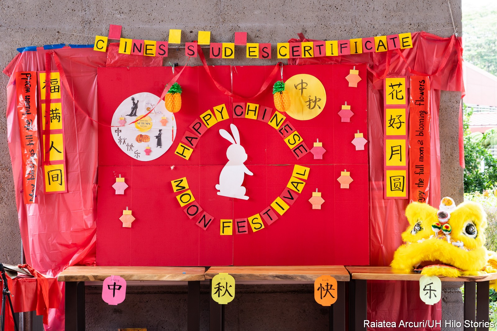 "Red fabric backdrop with the words, ""Happy Chinese Moon Festival."