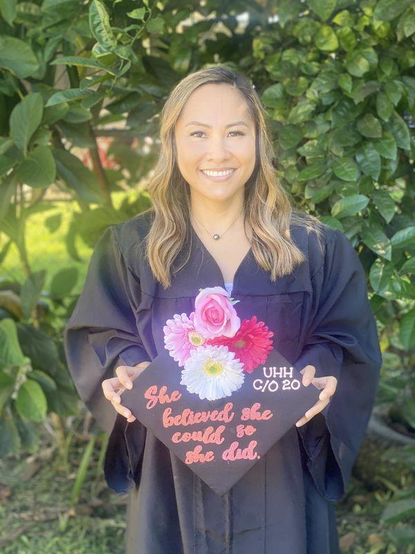 Janice Kaawaloa shows her decorated graduation cap