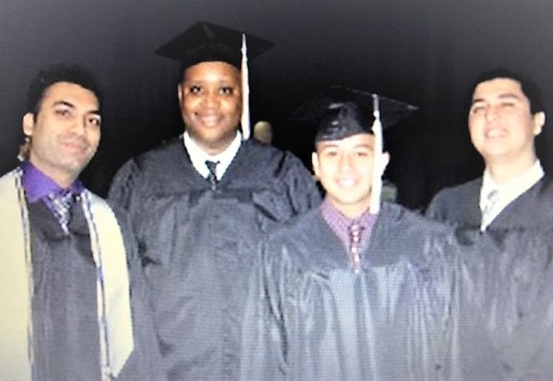 Michael David Whitley poses with other graduates