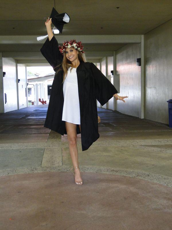 Kiana-Rae Chizuka Ellefsen jumping in a cap and gown