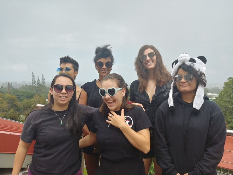 Science students laughing it up on top of STB