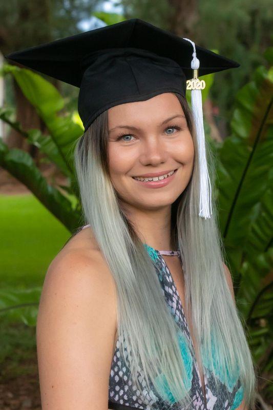 Ekaterina Kapoustina smiling in a graduation cap