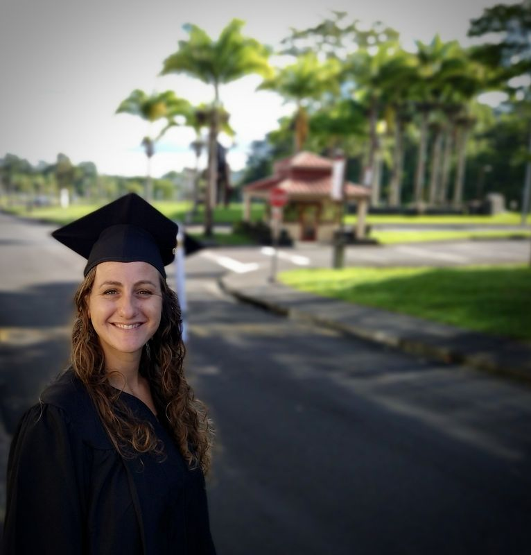 Cassandra Pensa smiling in a cap and gown